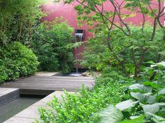 Waterfall, pond, bridge in small urban garden. del Buono Gazerwitz Landscape Architecture