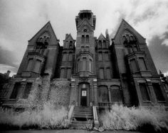 """Danvers State Hospital: Kirkbride Building."" Infrared photograph of an abandoned asylum, taken by Cyril Place (© 2004)."