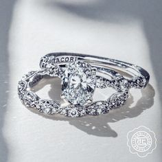 Oval-whelmingly beautiful. 💎 💙 This Petite Crescent oval-cut stack features round brilliant diamonds around the bands that create a marquise-shaped design detail for an intricate look to adore and love. Featured styles: HT2559OV85X65 and HT2558B. #OvalCutRing #OvalRing #Tacori #TacoriRing #engagementring #engagementringinspo Asscher Cut Diamond, Radiant Cut Diamond, Emerald Cut Diamonds, Oval Diamond, Princess Cut Diamonds, Diamond Bands, Tacori Rings, Tacori Engagement Rings, Designer Engagement Rings