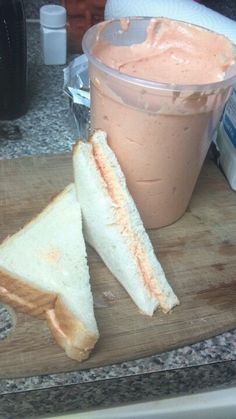 Sandwiches de Mezcla de Puerto Rico  1 can or jar one whole red pimento 1 can Spam 12 oz 1 block velveeta cheese use 1/2 only 1/2 cup milk  Cube cheese and ham and add to blender. Add pimento and liquid   Add milk slowly until spreadable consistency  You may add more or less milk depending on how thick you may want it.  Spread it on 2 slices of sandwich bread and enjoy!!