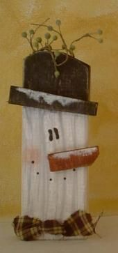 DIY Wooden Country Snowman ~ You can create a cute country snowman by using a 2x4