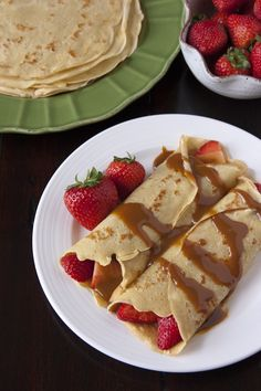 Strawberry Filled Crepes drizzled with Boozy Dulce de Leche from Muy Bueno