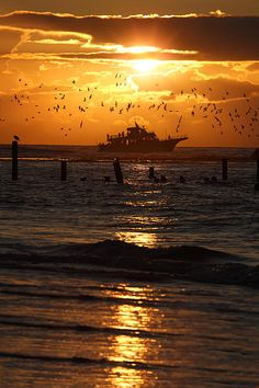 A fishing boat goes out to sea at sunrise.  Pictured from Ocracoke Island on the Outer Banks of North Carolina. Main website: http://www.picturenorthcarolina.com Fine art gallery (buy prints): http://www.dan-carmichael.artistwebsites.com/index.html Blog: http://www.picturenorthcarolina.com/north_carolina_pictures/ Facebook: https://www.facebook.com/dan.carmichael.169 Twitter: https://www.twitter.com/FineArtPic Google Plus: https://plus.google.com/108220676338347644845/