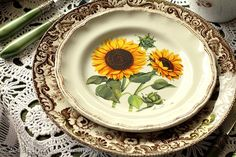 Love the brown transferware poking out from the sunflower plate.  Pat @ back porch musings