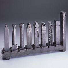 Menorah by Richard Meier (candle holder) for the Jewish Museum in New York, to commemorate 4,000 years of Jewish history.