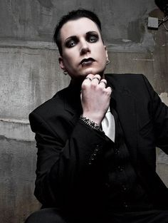 Chris Pohl of Blutengel. There aren't nearly enough dapper men wearing  eyeshadow on this board.