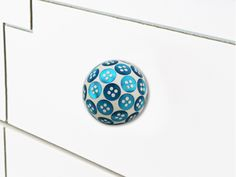 Colorful Button Knobs in bright colors available only at https://www.indianshelf.com/category/knobs-handles/