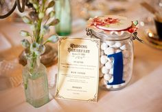 Kilner jars filled with sweets as table numbers - for the favours guests can move from table to table for their own choice of pick-n-mix
