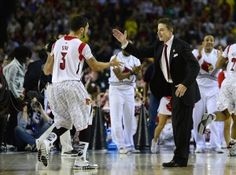 With a hard-fought win over Michigan, Louisville coach Rick Pitino became the first coach in college basketball history to win national championships at two different schools.