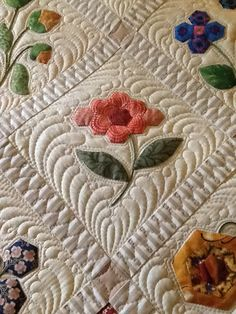 """Floral album quilt by Jo Botherway, pattern by Anne Sommerlad. Quilted by Katrina's Quilting (Australia): """"I have used loads of feathers to quilt this quilt, all of the flowers have been outlined and then echoed, then the freeform feathers have framed each flower."""""""