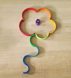 A flower designed from Grimm's 12-Piece Wooden Rainbow stacker