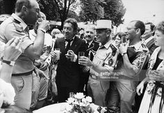 Serge Gainsbourg clinks glasses with toast soldiers and legionaries of the French army on July 14,1985 at the Elysée palace for Bastille Day in Paris, France.