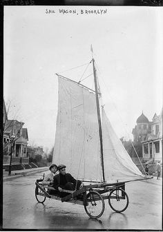 Sailing a wagon in the Brooklyn rain, ca. 1910