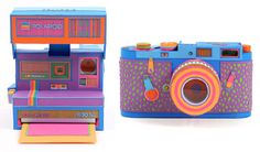 Paper Polaroid and Leica cameras! And in gorgeous psychedelic colors, no less.