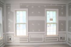"This shows a Living room with a 5 piece crown moulding, 2 piece chair rail, panel moulding shadowboxes, 5"" baseboard, and windows with a 3.5"" Adams casing."