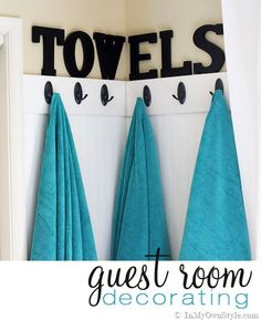 Guest-Room-Decorating-Ideas---where-to-hang-all those towels needed.  Use in Kids bathrooms, too!