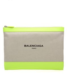 Balenciaga - Canvas and leather clutch - Balenciaga's roomy clutch bag comes crafted in Italy from beige canvas and neon yellow leather. The brand name sits proudly on the front, while a sizeable internal pocket allows for easy organisation. Work yours from coffee breaks to dinner dates. seen @ www.mytheresa.com