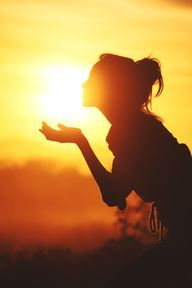 Blowing kisses into the sun.
