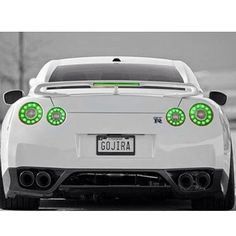 White Nissan GT-R with green lights