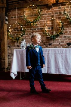 Page boy wears a blue checked suit with green patterned bow tie. Images by Gemma Giorgio Wedding Ties, Wedding Blog, Ted Baker Suits, English Country Weddings, Display Family Photos, Pageboy, Checked Suit, Boys Suits, Maggie Sottero