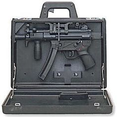 "HK MP-5K covert ""briefcase gun"". Note the trigger on the handle.  I haven't carried a briefcase lately, but I would like this one"