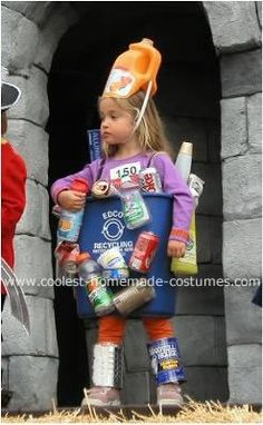 Homemade Recycling Bin Costume: While helping to take out the recycling in September, my daughter started playing with some of the containers and the idea just came to me to make her