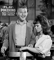 """Play Pokerino"", reads the sign in the background.  (That smiling young man is Martin Milner from Route 66...)"
