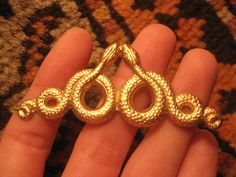 serpent barrette.