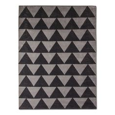 Add a piece of your personality to your living space with this Gray Plush Triangles Area Rug from Pillowfort™. The latex backing means it'll stay put wherever you want it, whether it's on hardwood, tiled or carpeted floors. The soft, plush material will feel great on your bare feet while the geometric design will complement your decor.
