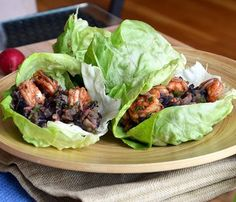 Asian Chicken Lettuce Wraps, Serves 4  INGREDIENTS:  2 tsp canola oil 8 oz white mushrooms, chopped 1 lb lean ground chicken 1 clove garlic, minced 1/2 tsp fresh ginger, minced 1 cup green onions, sliced 1 (8 oz) can sliced water chestnuts, drained and chopped 8 large lettuce leaves 1 tbsp toasted sesame oil 1/2 tbsp rice wine vinegar 3/4 tsp lower-sodium soy sauce 1/2 tsp honey crushed red pepper flakes, to taste DIRECTIONS: