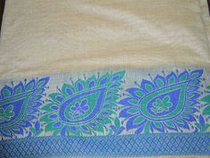 Blue and Green Woven Paisley Border Chanderi blended cotton silk fabric. The width of the border is about 5 inches throughout the length, horizontally.You can use this fabric to make dresses, tops,...