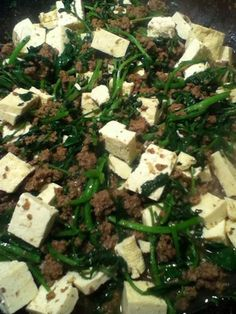 Hamburger with Tofu and watercress: Recipe by Tʻs All Kine Ono Grinds https://www.facebook.com/TsAllKineOnoGrinds2 2 lbs hamburger 1 bunch watercress, washed and chopped 3 pieces garlic, minced 1/3 cup soy sauce 1/4 cup water 2-3 tsp oyster sauce 1 container extra firm tofu, cubed