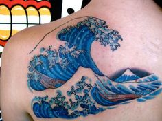30+ Wave Tattoo Images And Photos Ideas