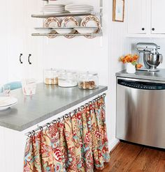 Consider using budget-friendly, curtain-style treatments rather than cabinet doors. Bright colors and patterns can infuse your kitchen with personality better than solid doors. Myhomeideas.com