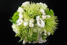 This bride's bouquet included fresh green colors including fuji mums and yoko onos with soft white lisianthus and roses. See more at www.naturenookonline.com.