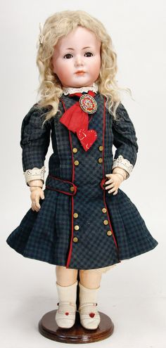 Ladenburger Spielzeugauktion -    K & R, SIMON & HALBIG 117 A, bisque porcelain character doll, 55 cm, brown sleepy eyes, closed mouth, dimple at chin, old mohair wig, jointed body, old clothes, underwear, shoes and socks Result: 1900.00 EUR
