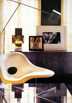 It's all in the Mix...Mid-century chair with modern fashion photography.....Interior design by Tom Ford