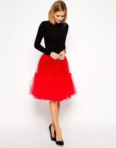 ASOS Full Midi Tulle Skirt in ruby or emerald. Too OTT for wedding but perfect for a fun winter outfit!
