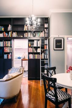 Small Space Hacks: 20 Tiny Apartments We Love via Brit Co Mini Loft, Small Space Living, Small Spaces, Living Spaces, My Living Room, Home And Living, Black Bookshelf, Bookcase Wall, Billy Ikea