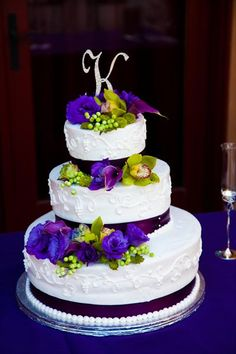 Purple and green wedding cake-- what do you think about something like this? it's got the pearls and ribbon, even as well as the topper you were talking about.