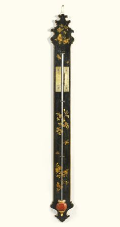 A Louis XV black japanned stick barometer, circa 1730 exposed tube, engraved gilt-brass scales with vernier, the case with shaped top and base and decorated in gilt with flowers and butterflies, faux porphyry and gilt cistern cover