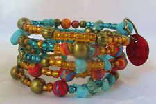 turquoise beaded bracelet memory wire wrap blue red gold tribal boho womens