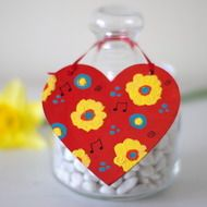 This red hanging heart is hand painted by me with acrylic paint on plywood. It features yellow and turquoise flowers against a red background. I like red yellow and turquoise colour combination and the heart looks like a mini painting. The spring heart...
