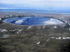"""Pingualuit Crater, a """"Crystal Eye of Nunavik""""  At the very top of northern Quebec in the Canadian Arctic, there is a perfectly round, water-filled crater that can be seen from outer space. It was formed when a meteorite hit the Earth 1.4 million years ago, making it one of the oldest lakes in the Western hemisphere."""