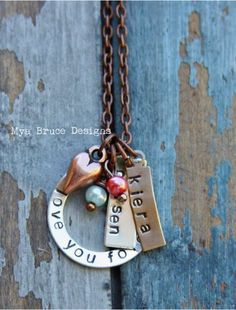 stamped metal necklace.  Love it.  @ Eden Junell. I'm sure hubby wants to get something like this for me this mothers day!