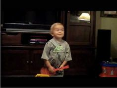 Same kid - couple years older.... check out the guitar change between songs, crack me up!