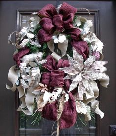 """Gorgeous and elegant wreath based on 24-inch diameter artificial pine wreath: 9 yards of 4"""" luxurious eggplant velvet ribbon, beautiful taupe 2.5"""" ribbed ribbon for the background & flowing tails, a stunning platinum glittered reindeer perched on the left side & a huge (12"""" across) platinum velvet beaded poinsettia (looks like jewelry). There is a beautiful balance of sparkle & softness."""