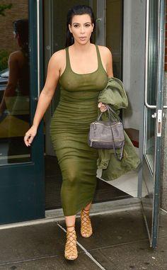 Kim Kardashian's wearing a green tank Top dress after her pregnant red carpet debut at tge CFD awards. 2015  Kim Kardashian