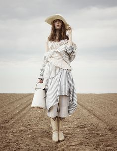Wild West style: Renli Su handwoven organic cotton jacket,matching skirt, and handwoven ramie fibre trousers, Marrika Nakk for Jessie Western cotton top, The Sleep Shirt Japanese cotton sleeveless nightie, Baptiste Viry Peruvian straw hat, Leather cowboy boots