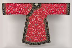 The color red symbolized longevity and fertility in the Chinese culture. Robes such as this one, which is from the Q'ing Dynasty, were often worn at weddings or birthday celebrations. The butterflies embroidered on this robe are associated with joy and longevity.